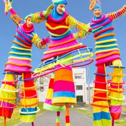Multi Coloured Stilt Walkers