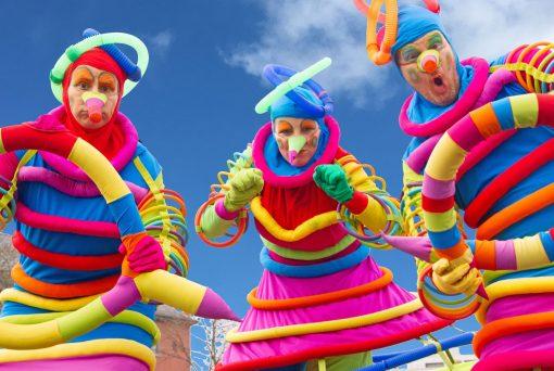 Multi Coloured Stilt Walkers